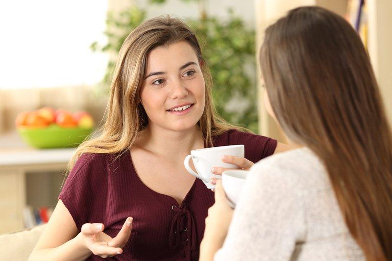 Woman telling friend